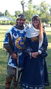 Author Scott Farrell and wife April in medieval costume at a living | history event - Photos © 2001 Ray Ford