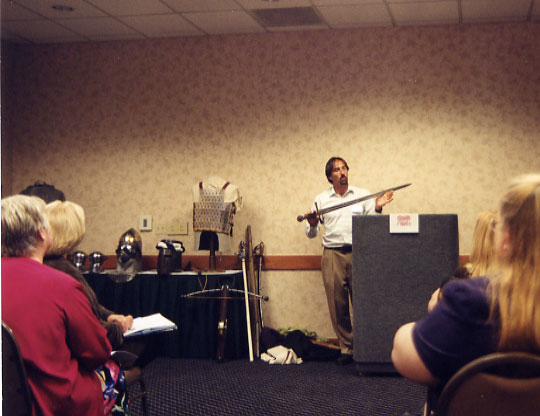 image of Scott speaking at seminar