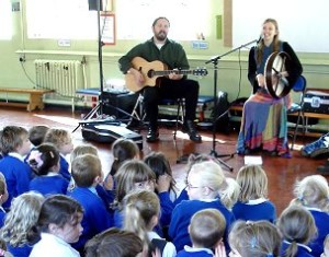 Heather and Ben playing at a school